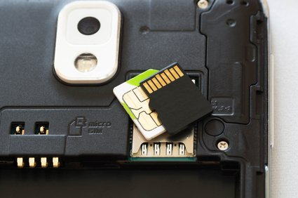 Upper shot of a dismantled smartphone wit SD ans SIM cards